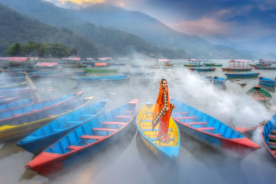 Women in sari standing on the boat,Phewa lake,Pokhara city , Nepal