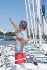mature sailing professor giving lesson