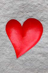 Red heart on grey background