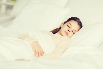 girl sleeping in bed at home