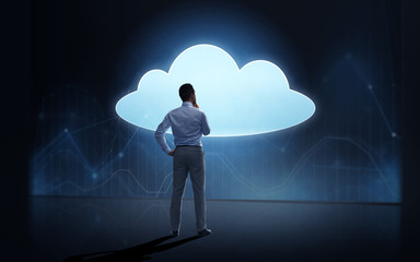 businessman at cloud projection over dark