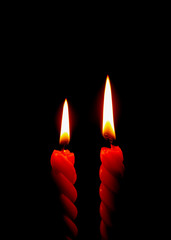 Two Red Candles Burning On the Black Background, Vertical Picture