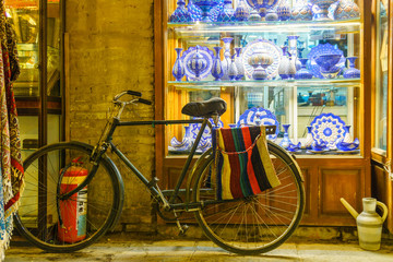 handicraft at bazaar of isfahan with bike an pottery