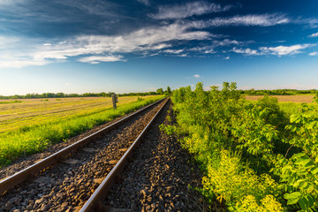 Beautiful rural european countryside, with infinite horizon and old railroad, on a fine spring day