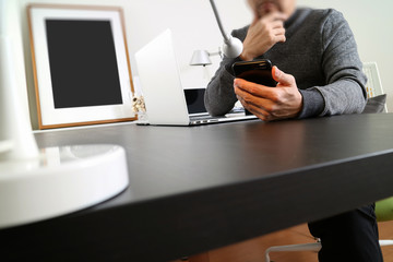 businessman working with smart phone and digital tablet and laptop computer in modern office