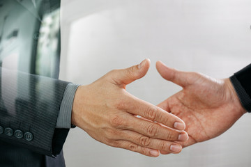 Business partnership meeting concept.photo businessmans handshake. Successful businessmen handshaking after perfect deal.close up