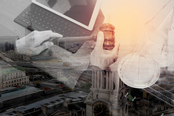double exposure of justice and law concept.Male judge in a courtroom with the gavel,working with smart phone,digital tablet computer docking keyboard,brass scale,on wood table,London architecture city