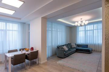 room beige sofa and chandelier