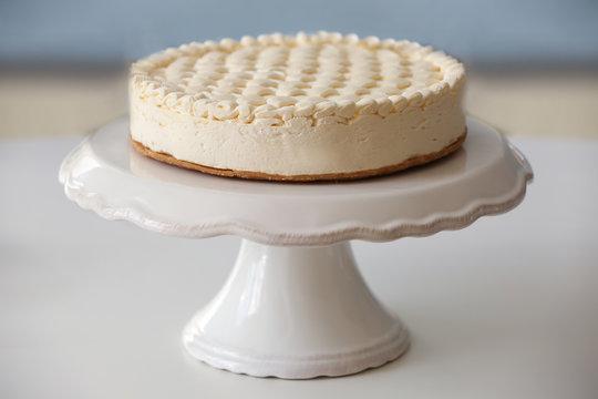 Delicious plain cheesecake on white table