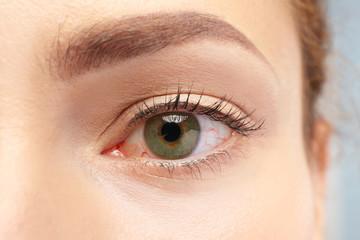 Brown-eyed female face, closeup