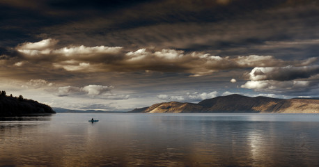 Kayaker On Open Lake   Stormy Clouds Moody
