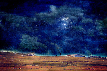 Luminous cloudy night sky over farmland with shining constellations and radiating cartography lines. Grunge, aged, textured digital manipulation. Searching and charting outer space concepts.