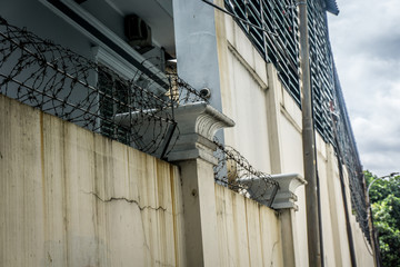 High wall of a house with barbed wire photo taken in Jakarta Indonesia