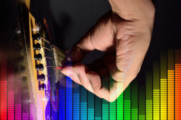 Closeup of a acoustic guitar is playing in a public festival.Equalizer made in a software and merge them together in photography software 8 layer use.