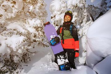 Woman snowboarder having fun.