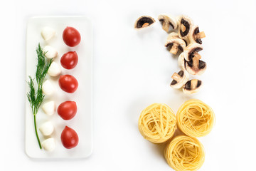 An upper view on a white lay and Italian food ingredients - pasta, tomatoes, greens, mushrooms. Top view with copy space.