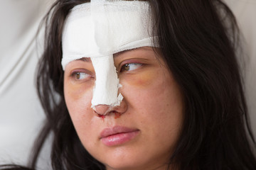 Plastic surgery, girl with medical bandage on her face