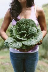 Woman holding freshly picked bok choi