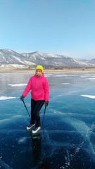 Skater girl on the ice of Lake Baikal Olkhon