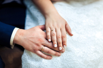 bride hands with wedding rings, close-up