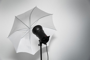 photo studio lightning - strobe flash with white umbrella