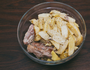 Baked potatoes with meat in a plate