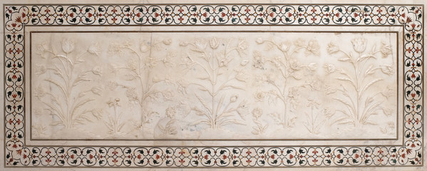 Mughal stone art on the facade of the Taj Mahal (Crown of Palaces), an ivory-white marble mausoleum on the south bank of the Yamuna river in Agra, Uttar Pradesh, India
