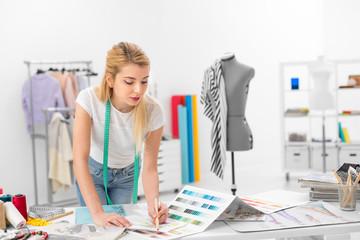 fashion designer colouring a sketch