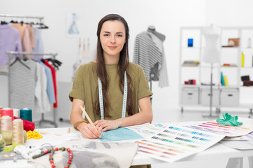 fashion designer sitting at desk