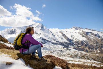 a hiker in the Pyrenees in spring with snow