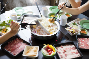 chinese foods Double flavor hot pot on the table.