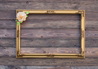 Baroque, gold, old, victorian, empty frame on a wooden wall