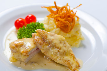 Chicken breasts chops stuffed with English bacon and cheese, served, with mashed potato
