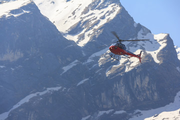 Red helicopter and Himalaya Annapurna mountain, Nepal