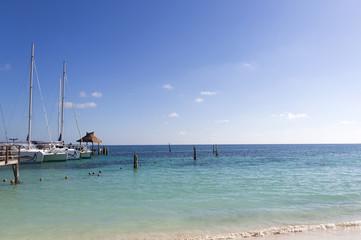 The Caribbean sea shore at the docks. Harbor full of boats.