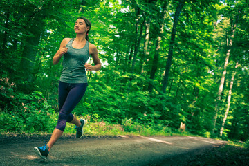 Young Woman Jogging In The Forest