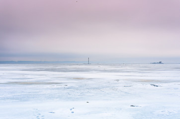 Old lighthouse in the middle of the frozen sea