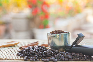 fresh coffee bean and coffee scoop on table