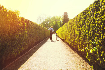 Mother and son walking outdoors on the nature background with copy space.