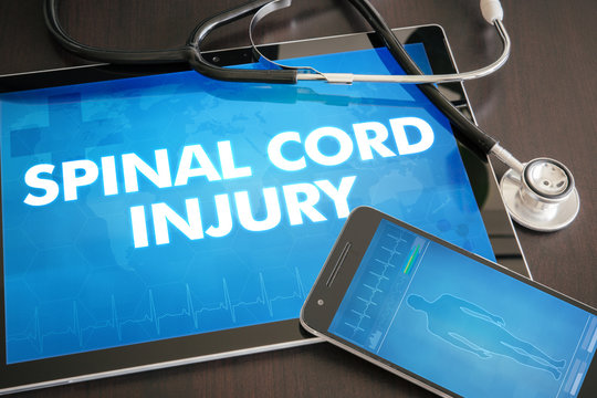 Spinal cord injury (neurological disorder) diagnosis medical concept on tablet screen with stethoscope