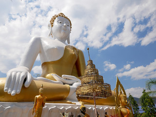 Giant Buddha statue at Wat Phra That Doi Kham (Temple of the Golden Mountain) in Chiang Mai, Thailand