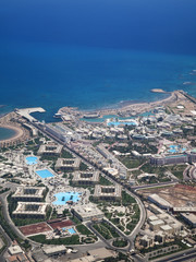 View on the touristic resort and Red Sea from an airplane