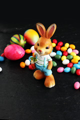 Sugar rabbit and easter eggs on stone grey