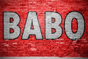 Babo Ziegelsteinmauer Graffiti