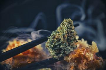 "Macro detail of cannabis bud ""black tuna"" marijuana strain with sushi chopsticks"