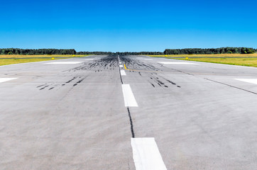 Runway at the airport and the blue sky conceptual aviation