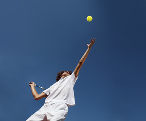 tennis player with racket during a serve in match game