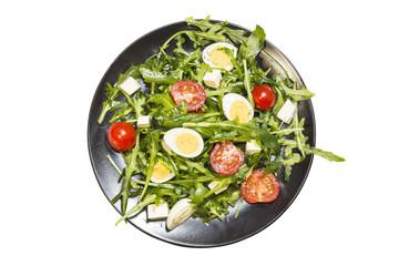 Quail eggs salad on a plate