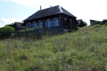 Wall Mural - Very old wooden house in the remote Russian village in the summer