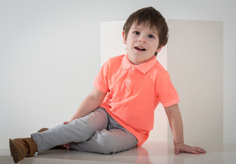 Little stylish fashion model - boy on white backgrpund in modern clothes